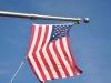 USA, Nowy Jork – flaga zawieszona na Empire State Building